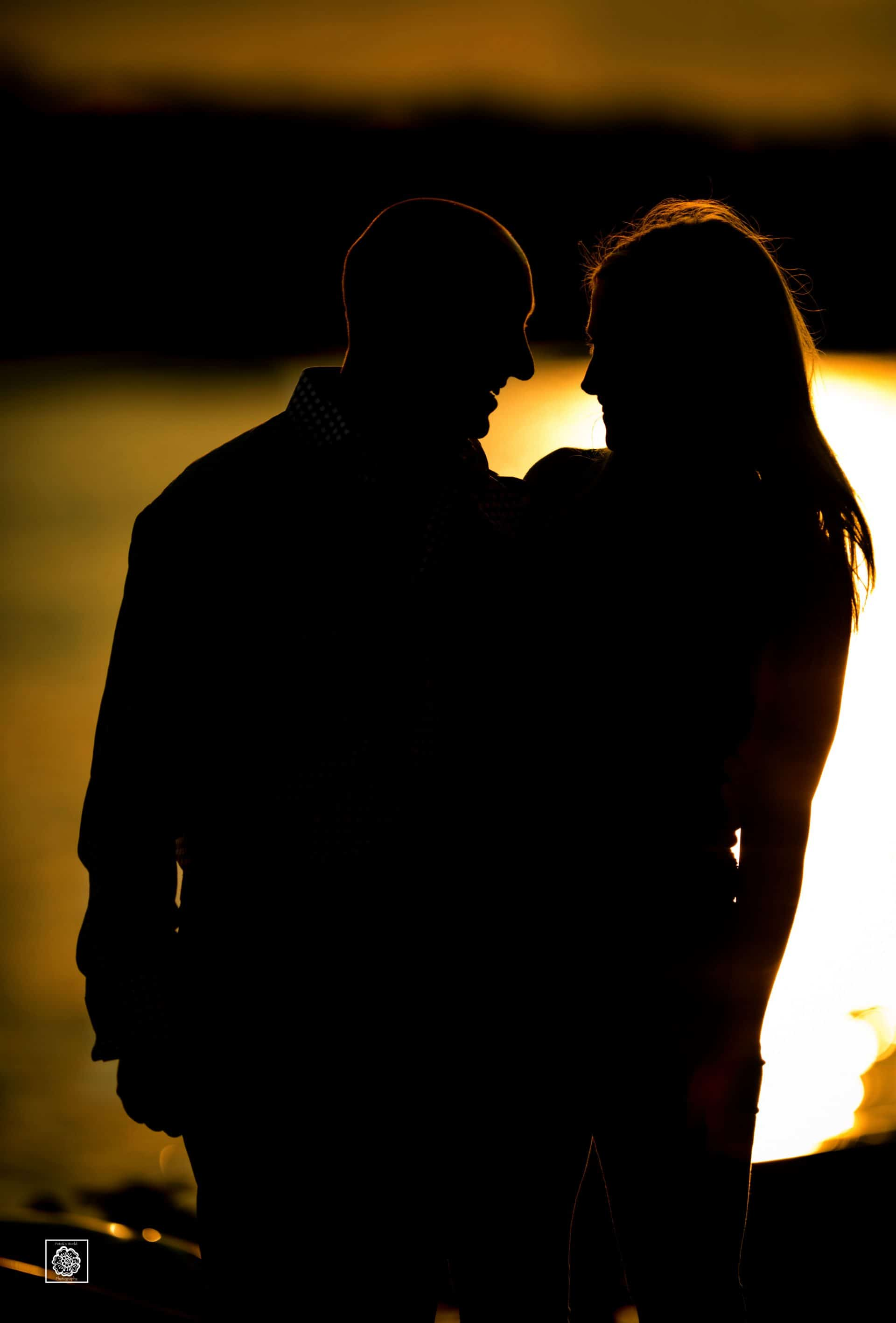 Sunset engagement photo silhouette at the Georgetown waterfront by DC wedding photographers of Potok's World Photography
