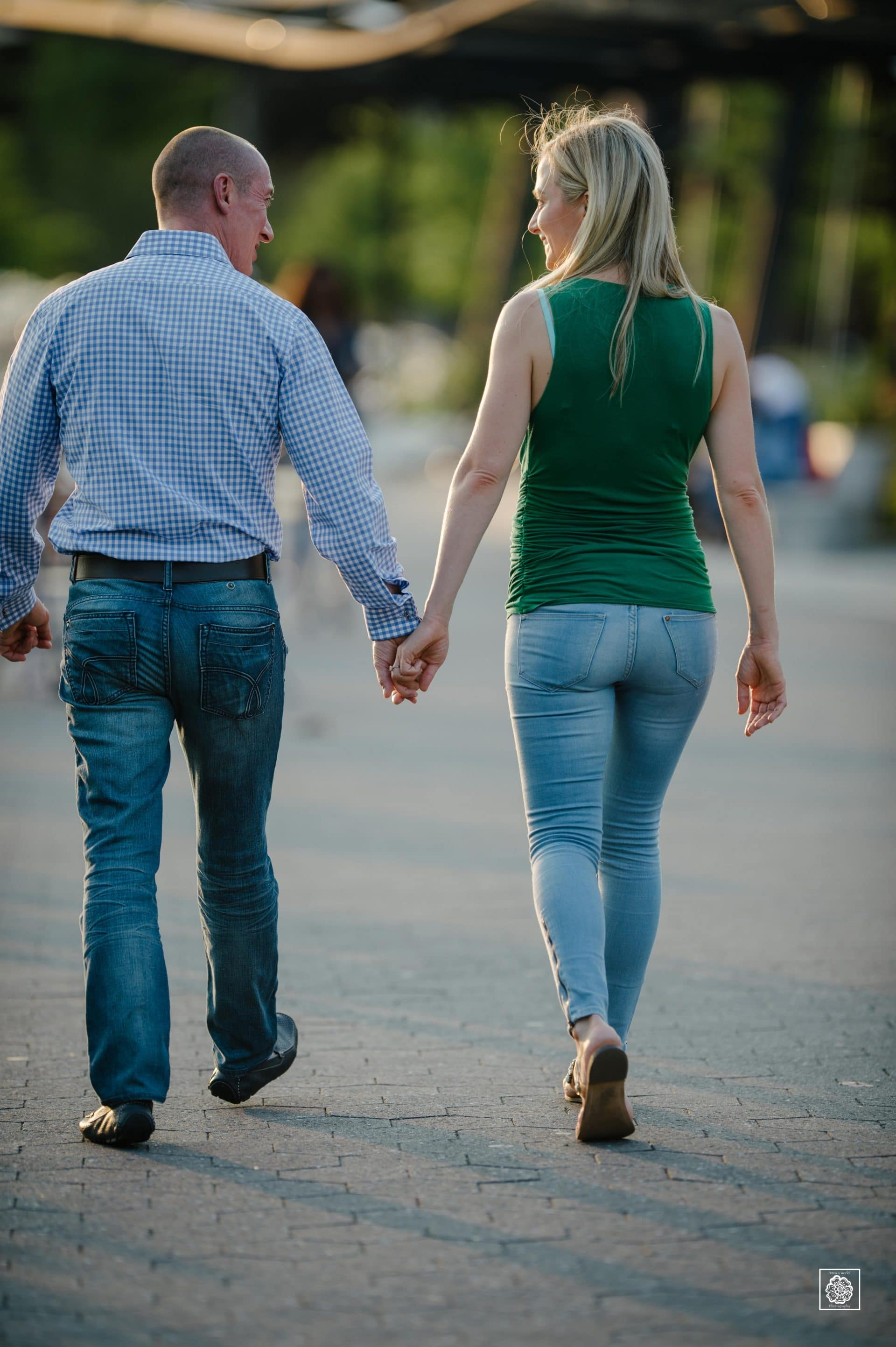 Couple walking hand in hand during engagement photo session at the Georgetown waterfront by DC wedding photographers of Potok's World Photography