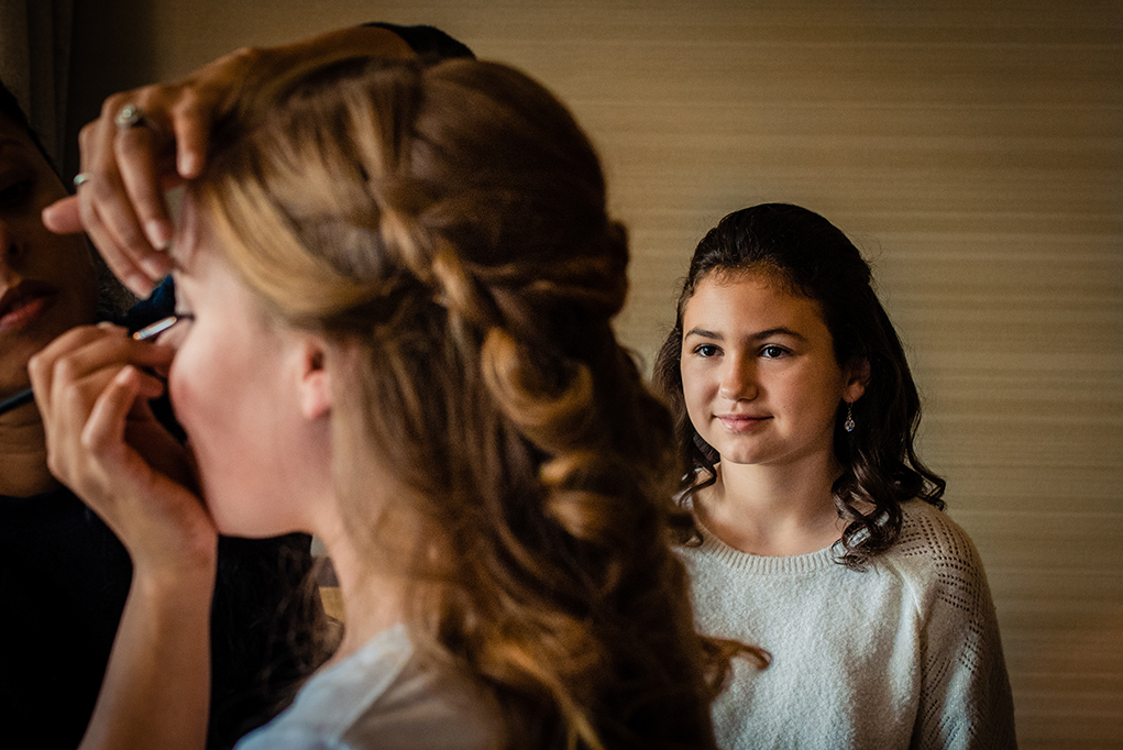 Bride getting ready with flower girl watching at Omni Shoreham DC wedding by DC wedding photographers of Potok's World Photography