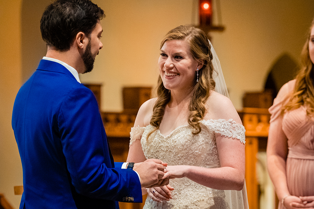 Bride and groom ring exchange at Dahlgren Chapel at Georgetown University before Omni Shoreham DC by DC wedding photographers Potok's World Photography