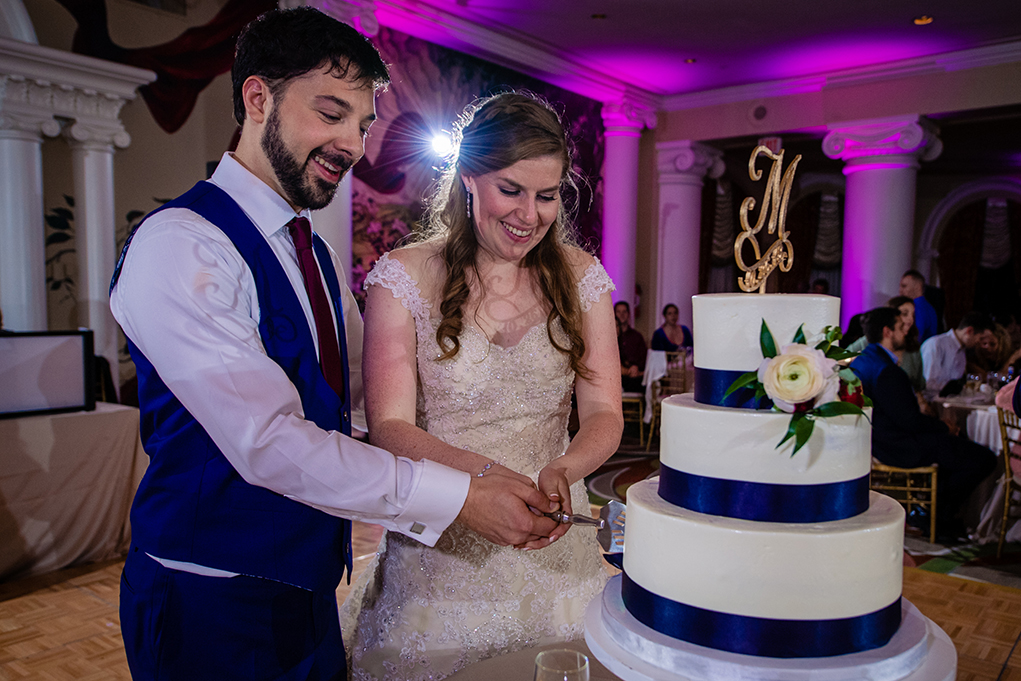 Bride and groom cake cutting at the Omni Shoreham DC wedding by DC wedding photographers Potok's World Photography