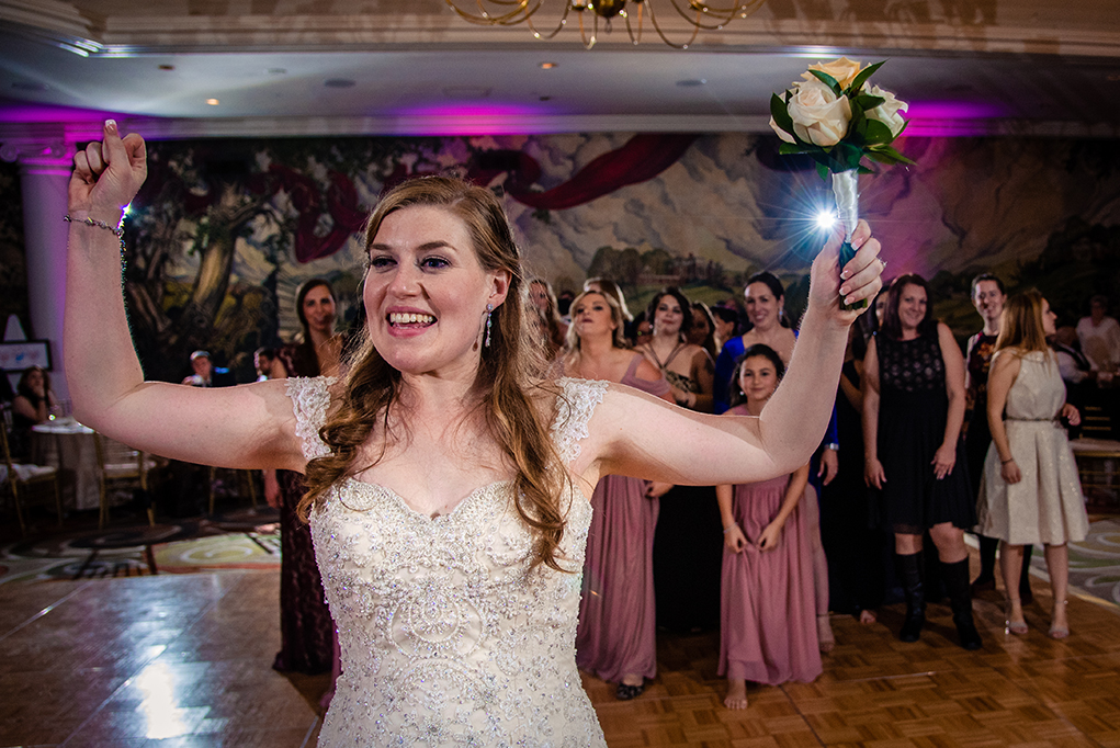 Bouquet toss by the bride at the Omni Shoreham DC wedding by DC wedding photographers Potok's World Photography