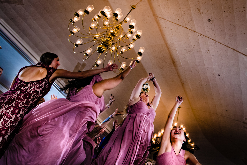 Bridesmaid catching the bouquet at reception at the Omni Shoreham DC wedding by DC wedding photographers Potok's World Photography