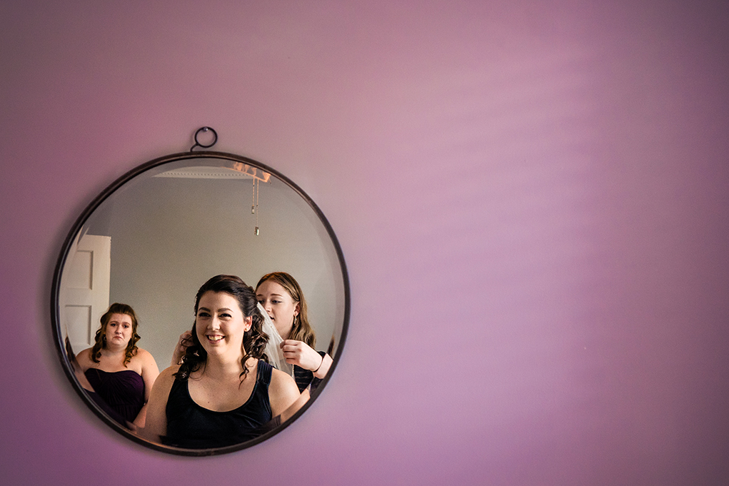 Bride getting ready with her sisters before wedding at the City Club of Washington by DC Wedding photographers Potok's World Photography
