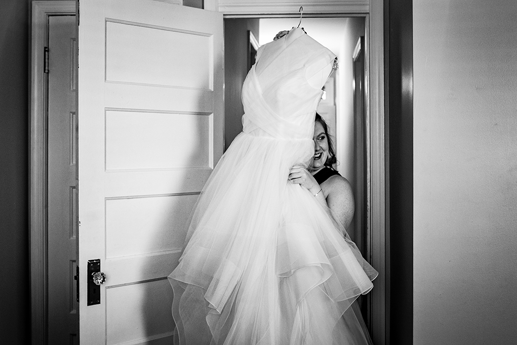 Bride getting ready with Hayley Page wedding dress before City Club of Washington wedding by DC wedding photographers of Potok's World Photography