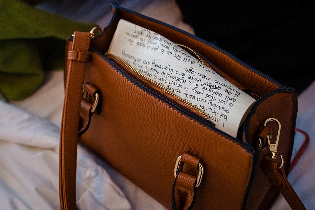 Wedding vows in bridal purse before their City Club of Washington wedding by Anji and Pete Martin, DC wedding photographers Potok's World Photography