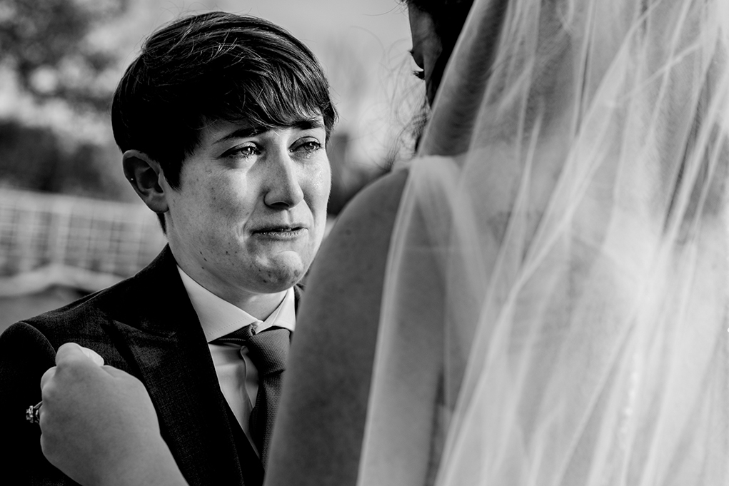 First look in Alexandria by two brides before their City Club of Washington wedding by DC wedding photographers Potok's World Photography