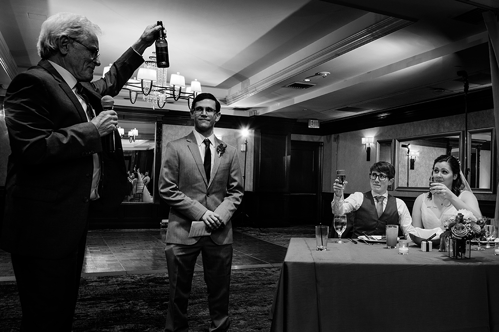 Toast in remembrance of absent grandparents at City Club of Washington reception by DC wedding photographers Anji and Pete Martin of Potok's World Photography