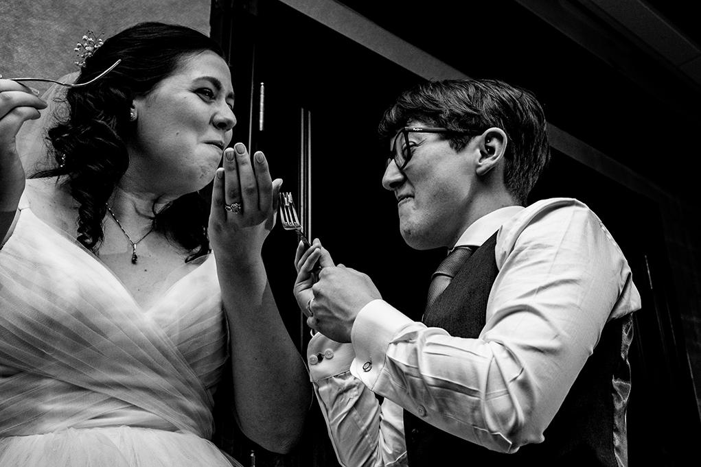 Brides cutting cake at City Club of Washington reception by DC wedding photographers Anji and Pete Martin of Potok's World Photography