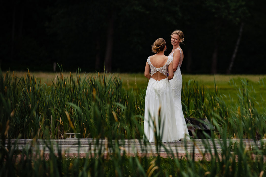 Small intimate same sex outdoor wedding with two brides in wedding dresses by Washington DC wedding photographers of Potok's World Photography