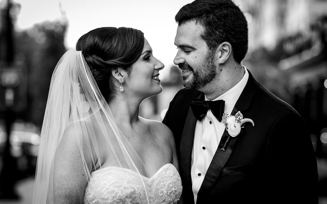 Outdoor picture of bride and groom in front of the St. Regis in Washington DC by Potok's World Photography