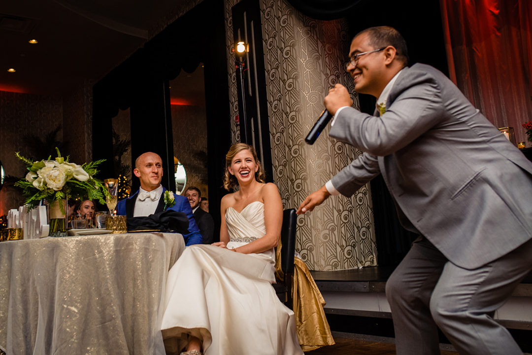 Best man speech with reaction from bride and groom at the Carlyle Club Alexandria wedding reception by DC wedding photographers of Potok's World Photography