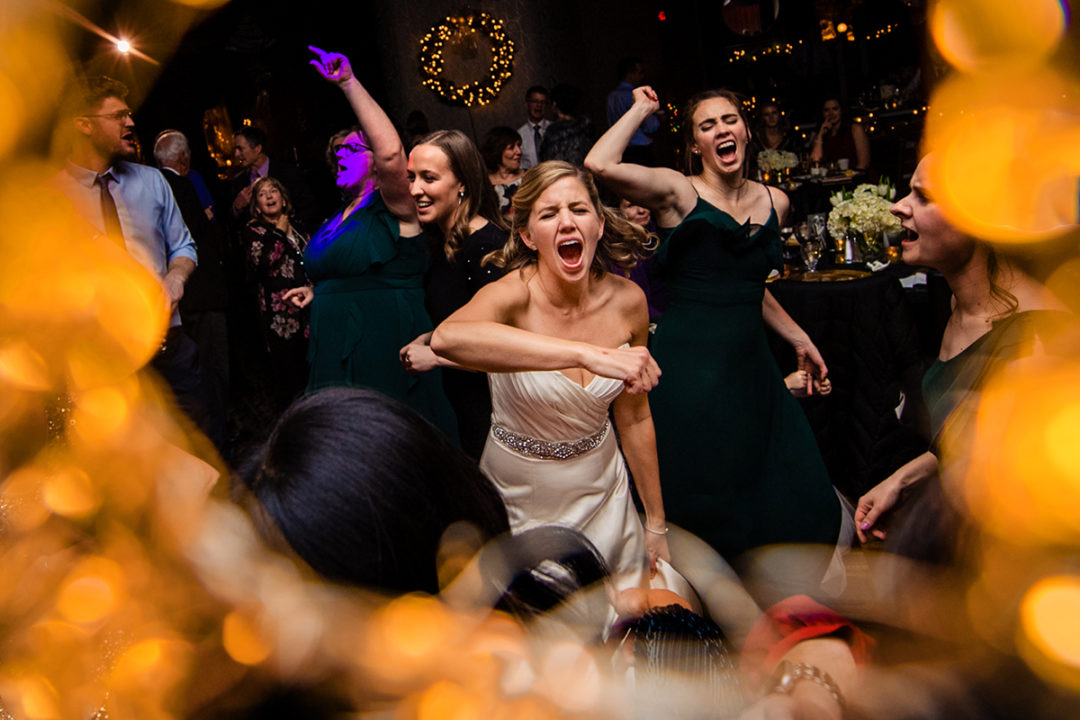 Bride and bridesmaids dancing at the Carlyle Club Alexandria by DC wedding photographers of Potok's World Photography