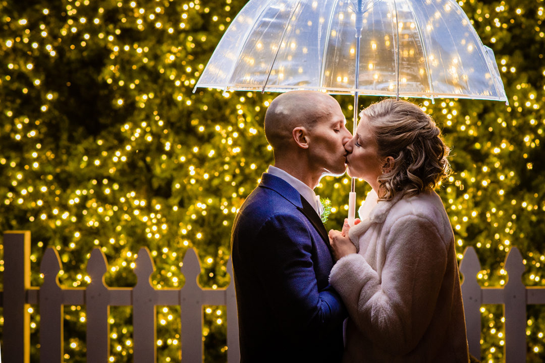 Bride and groom portrait in front of a Christmas tree in old town Alexandria before Carlyle Club reception by DC wedding photographers Potok's World Photography