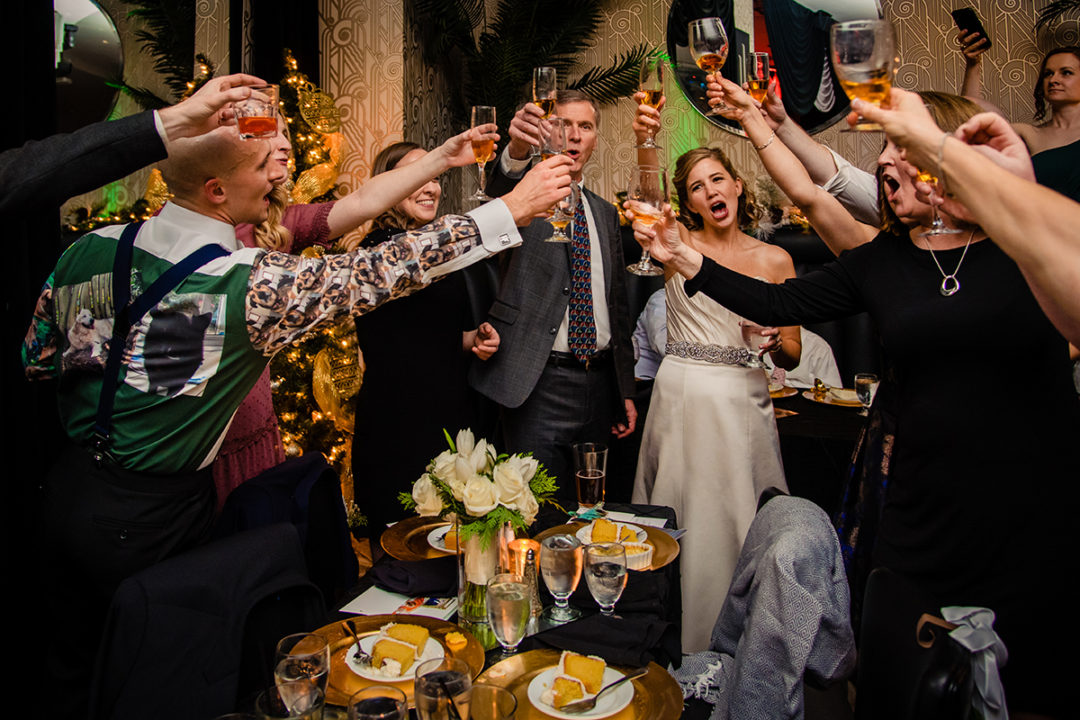 Bride and groom toast with their guests at Carlyle Club Alexandria by DC wedding photographers Potok's World Photography