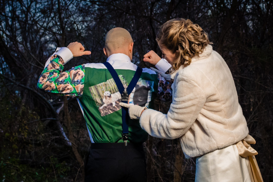 Groom surprises bride by wearing shirt with pictures of her dogs printed on the back in Old Town Alexandria by DC wedding photographer of Potok's World Photography