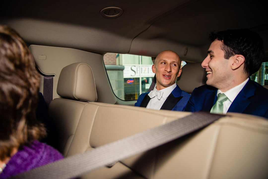 Groom and best man in the car on the way to the church ceremony before the reception at the Carlyle Club Alexandria by northern Virginia wedding photographers of Potok's World Photography