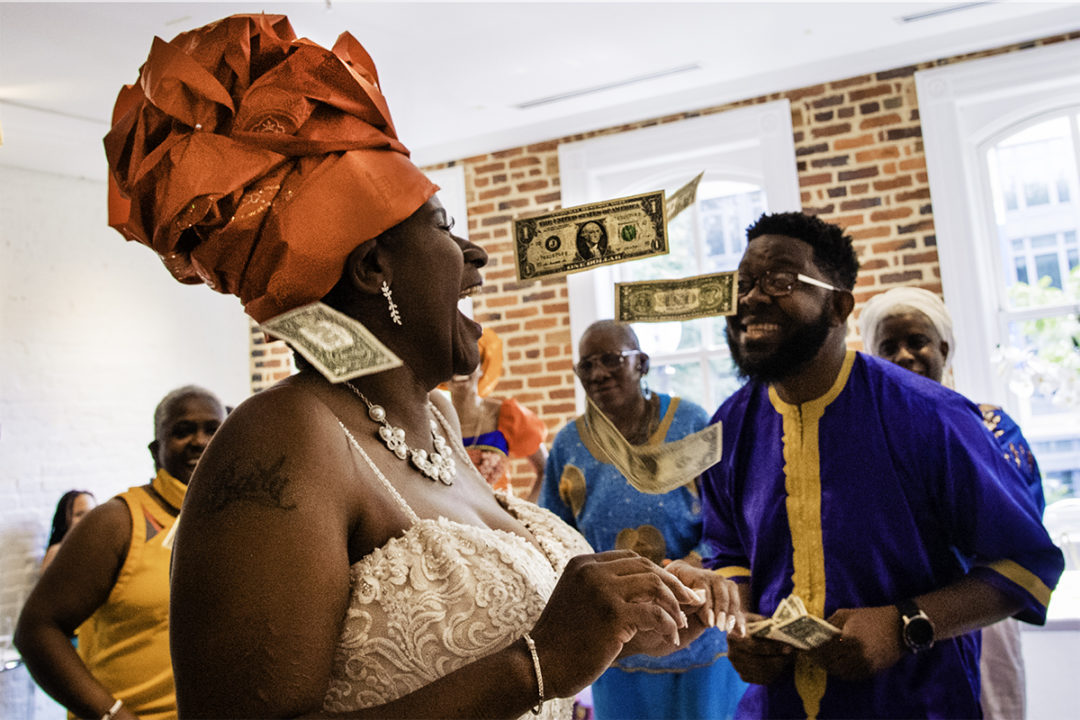 Money dance with Ghanaian bride during Fathom Gallery micro wedding by DC wedding photographers of Potok's World Photography