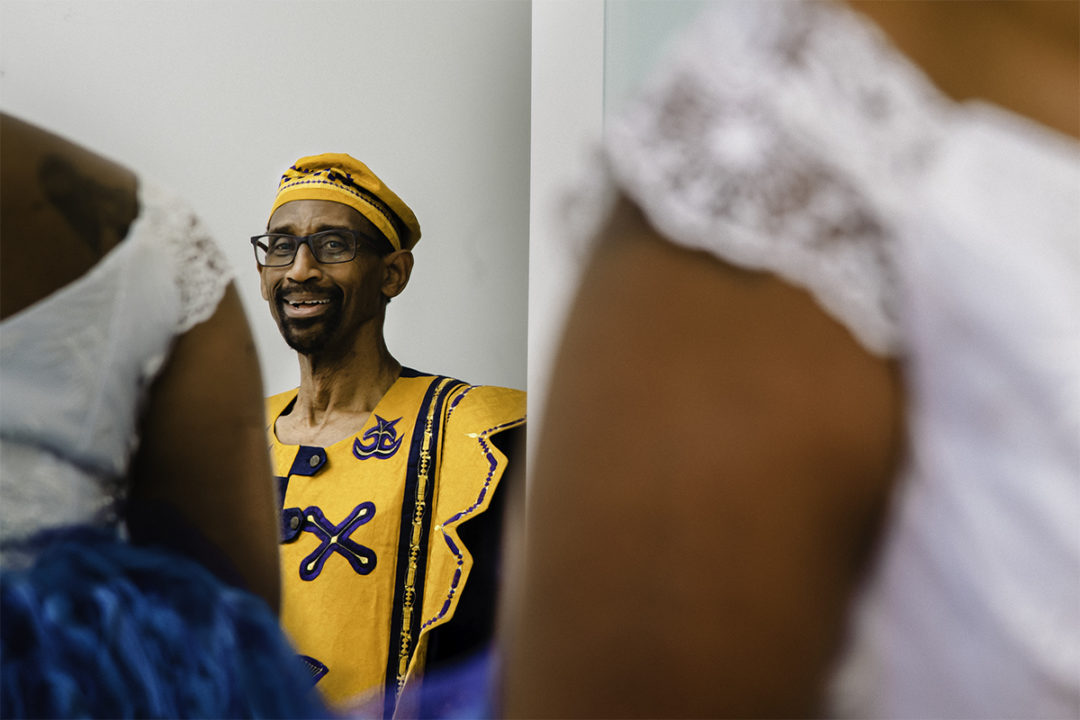 Ghanaian bride's first look with dad during micro wedding at Fathom Gallery by DC wedding photographers Potok's World Photography