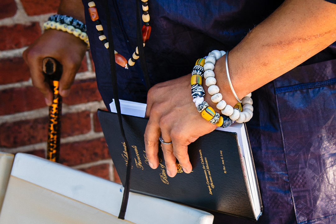 Book of prayers and celebrations at Fathom Gallery micro wedding by DC wedding photographer Potok's World Photography