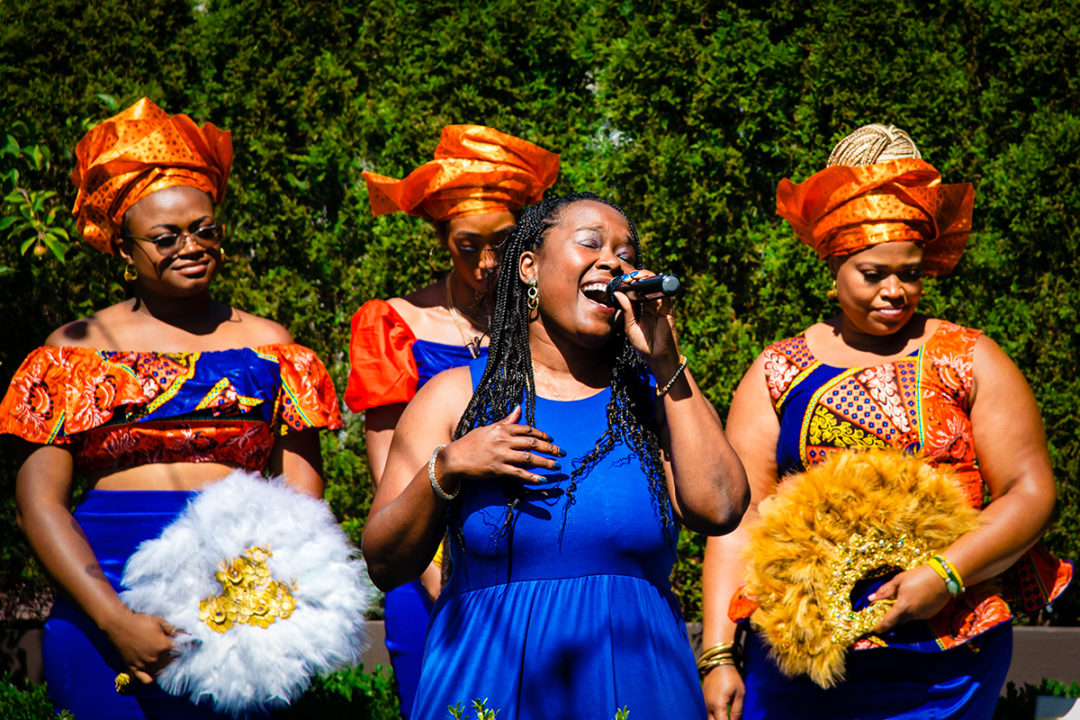 """Sister of the groom singing """"At Last"""" by Etta James during Fathom Gallery micro wedding ceremony by DC wedding photographers Potok's World Photography"""