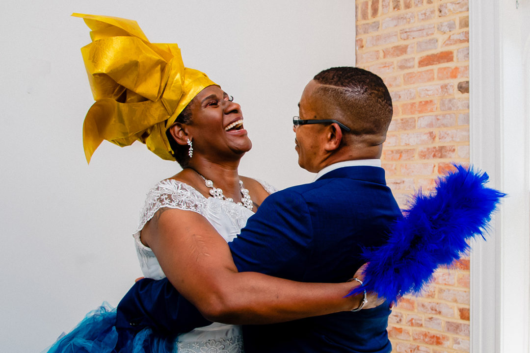 Couple's portraits of ghanaian bride and her groom during a micro wedding at Fathom Gallery by DC wedding photographers of Potok's World Photography