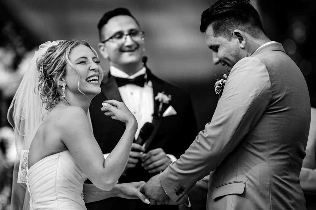 Documentary wedding photography in Washington DC of bride laughing during outdoor ceremony at Tudor Place in Georgetown by Anji Martin of Potok's World Photography, DC wedding photographer