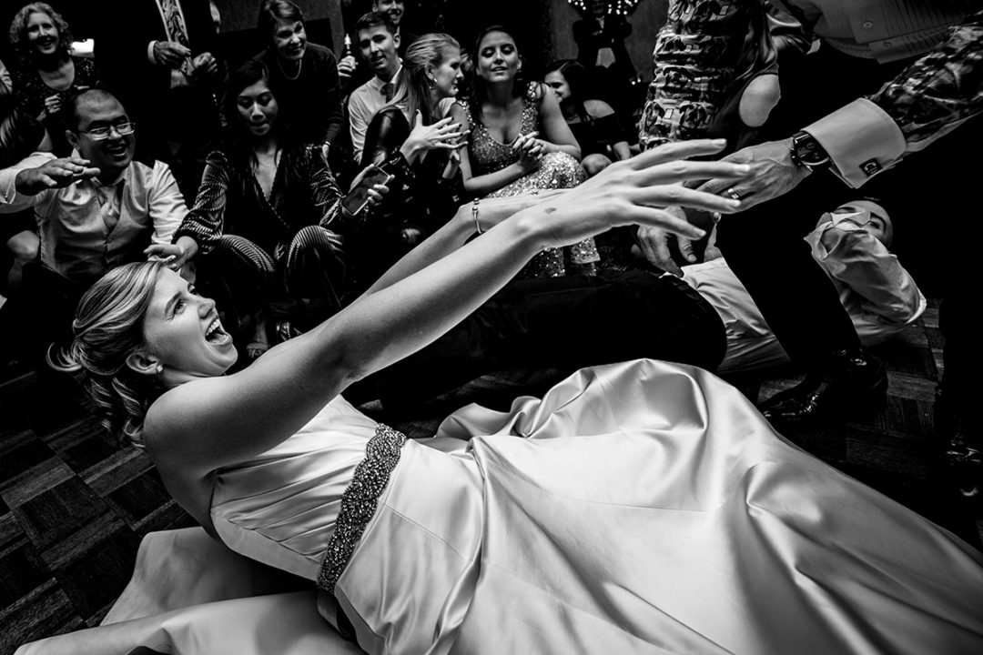 Documentary wedding photography of bride dancing to the song shout during wedding reception at the Carlyle Club in Virginia by Potok's World Photography, Washington DC wedding photographers