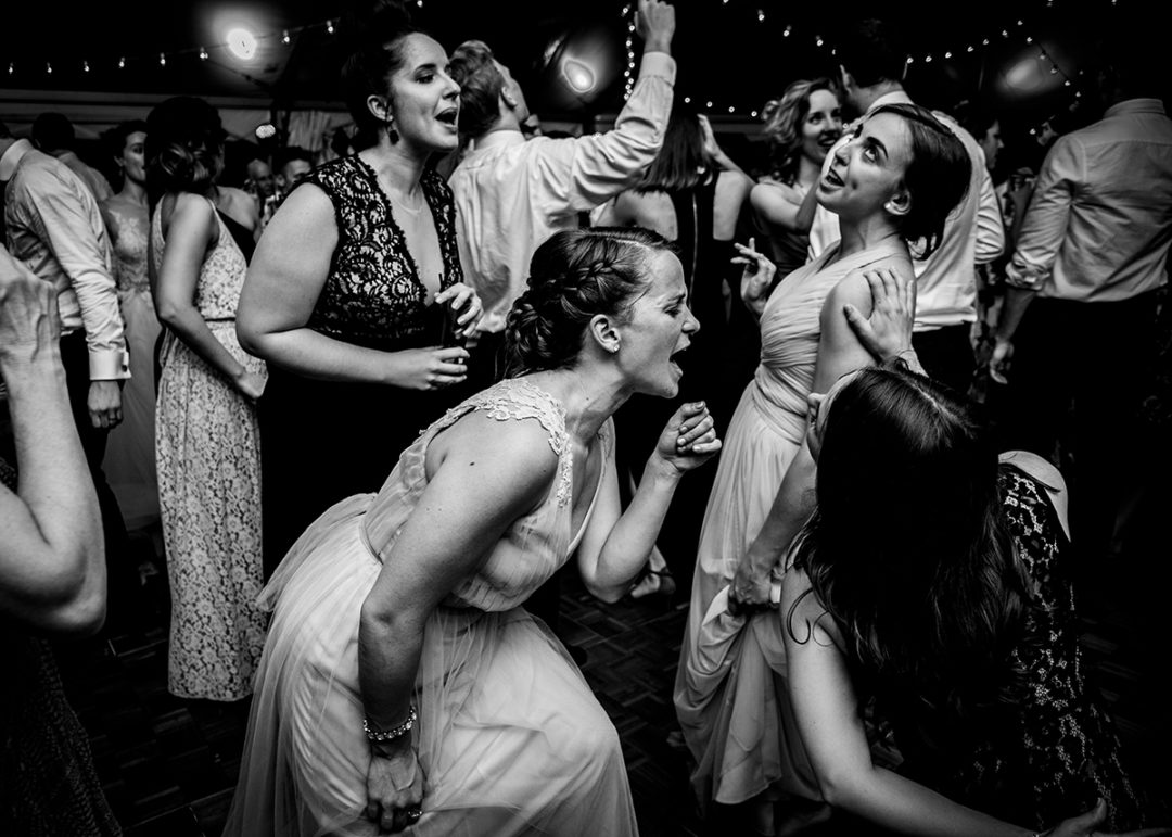 Documentary wedding photography in Washington DC of bridesmaids dancing during reception at 101 Constitution by Anji Martin of Potok's World Photography, DC wedding photographer