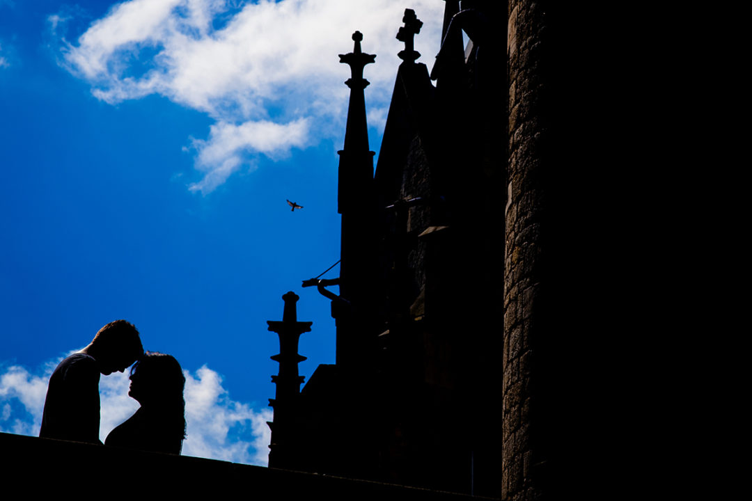 Silhouette of couple against clear blue sky during Marienburg Castle engagement photos in Germany by Washington DC wedding photographers Potok's World Photography