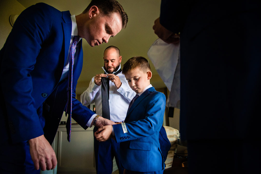 Groom and groomsmen getting ready at Landsdowne Spa and Resort in Leesburg before the Vanish Brewery wedding by DC wedding photographer Pete Martin of Potok's World Photography