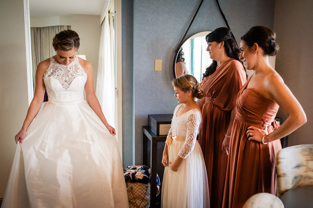 Bride getting ready with her bridesmaids at Lansdowne Resort and Spa in Leesburg before her Vanish Brewery wedding by DC wedding photographers Potok's World Photography