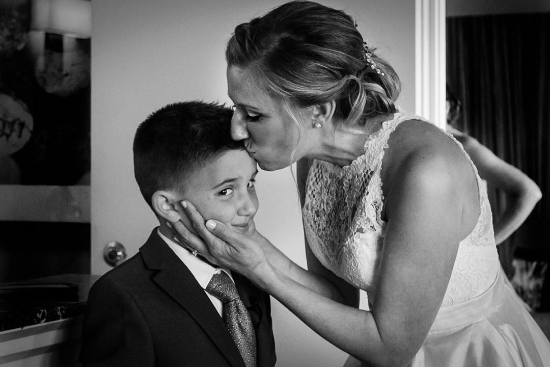 First look bride and son at Landsdowne Spa and Resort in Leesburg before Vanish Brewery wedding by DC wedding photographer Anji Martin of Potok's World Photography