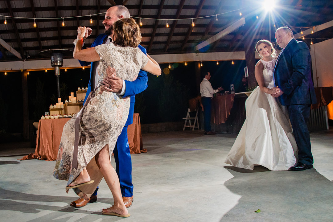 Parent dances at wedding reception at Vanish Brewery in Virginia by DC wedding photographer of Potok's World Photography