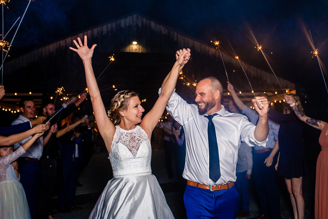 Couple doing their sparkler exit at Vanish Brewery wedding in Virginia by DC wedding photographer of Potok's World Photography