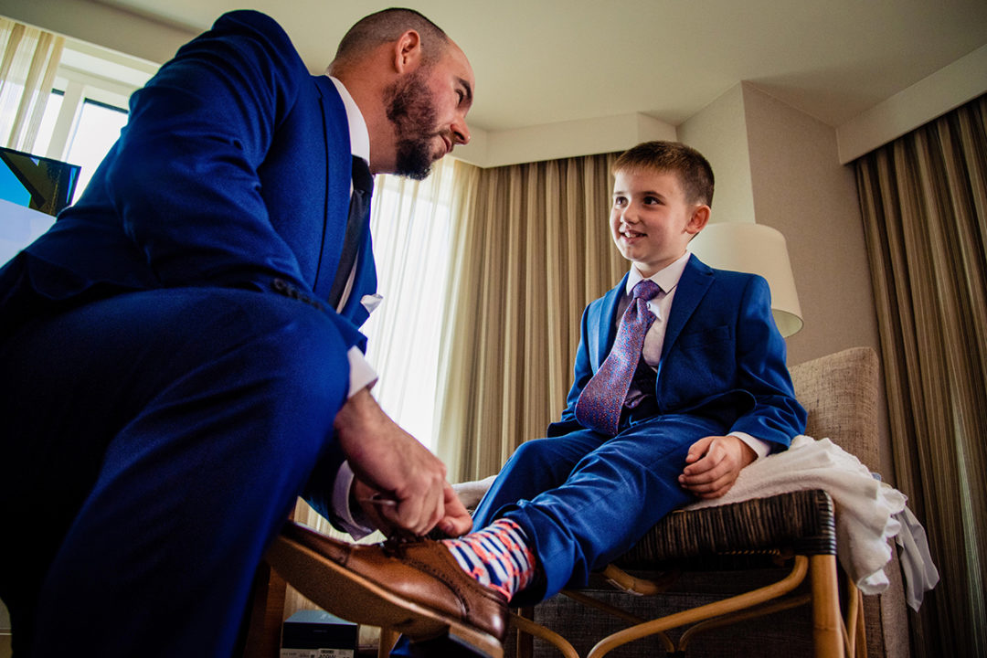 Groom getting ready moment at Lansdowne Resort in Virginia by DC wedding photographers of Potok's World Photography
