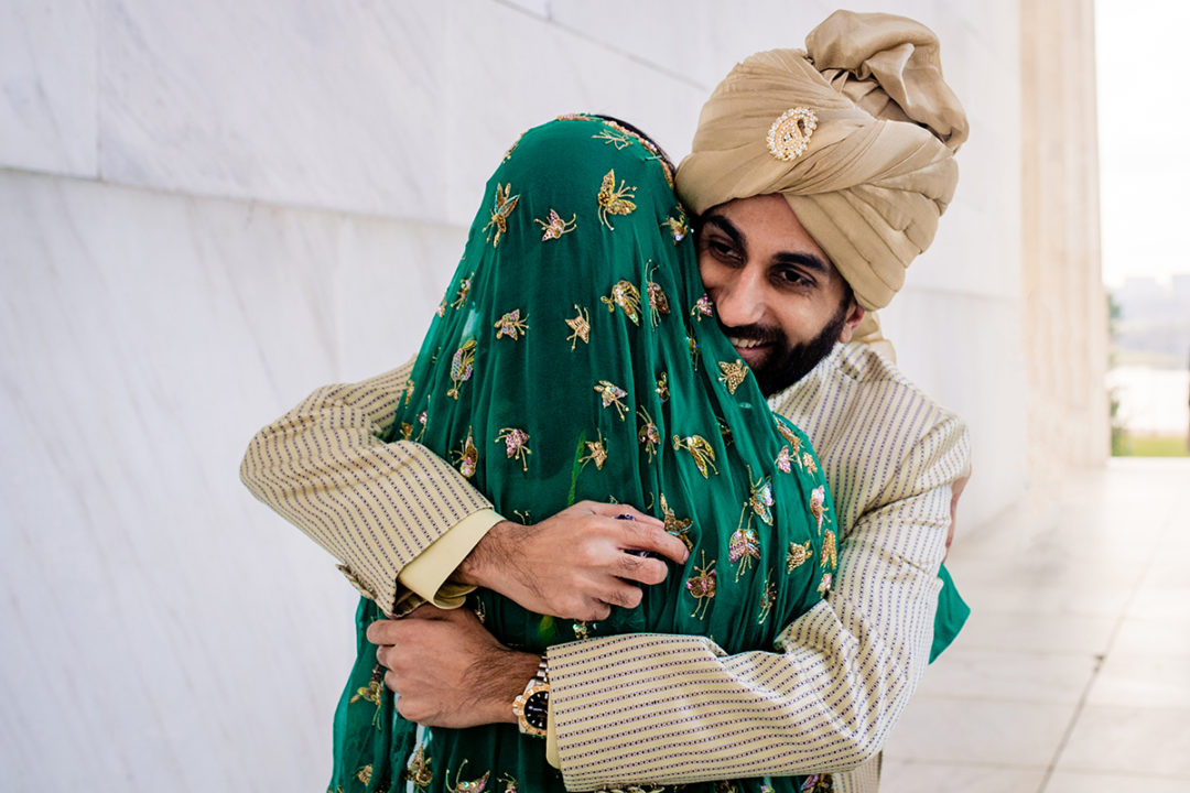 South-asian bride and groom's first look at the Lincoln Memorial before their DC War Memorial mini wedding by Potok's World Photography