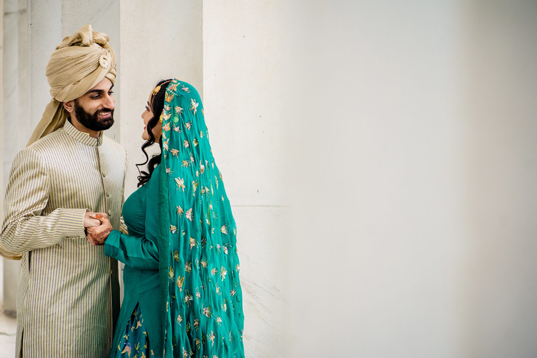 South-asian bride and groom portrait at the Lincoln Memorial before their DC War Memorial mini wedding by Potok's World Photography