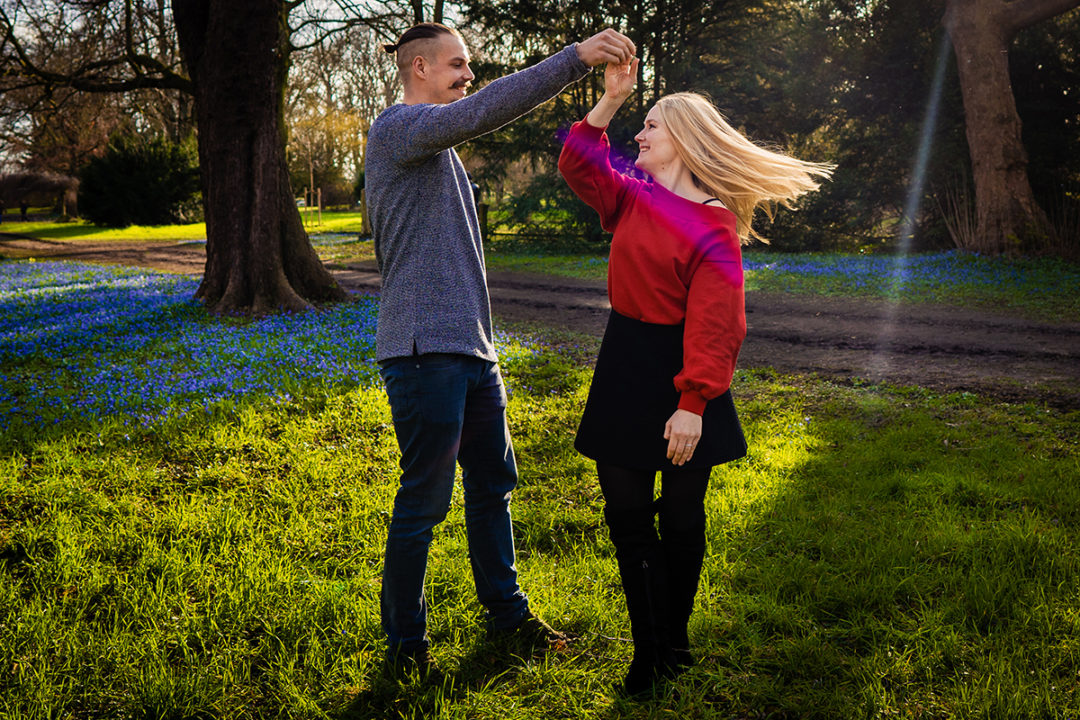 Outdoor spring engagement session of groom spinning his bride-to-be by DC wedding photographers of Potok's World Photography