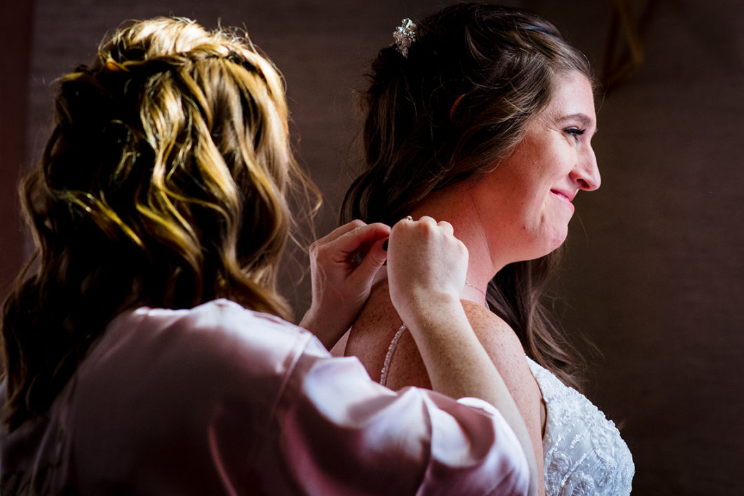 Getting ready moments with Bride and bridesmaid during destination wedding at the Windamere in Ohio by DC wedding photographers of Potok's World Photography