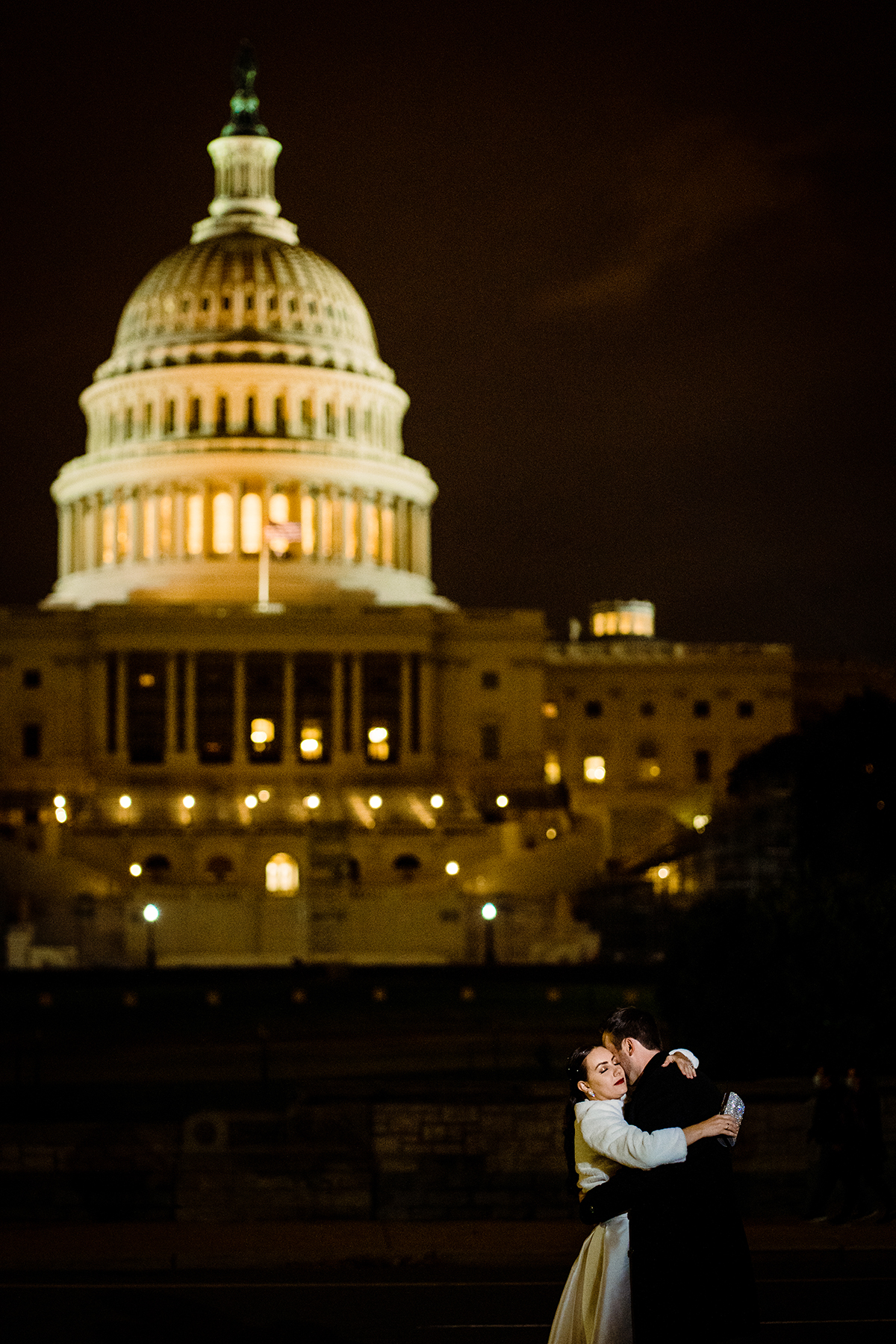 Nighttime Bride and groom portrait in front of the Capitol Building by DC wedding photographers of Potok's World Photography