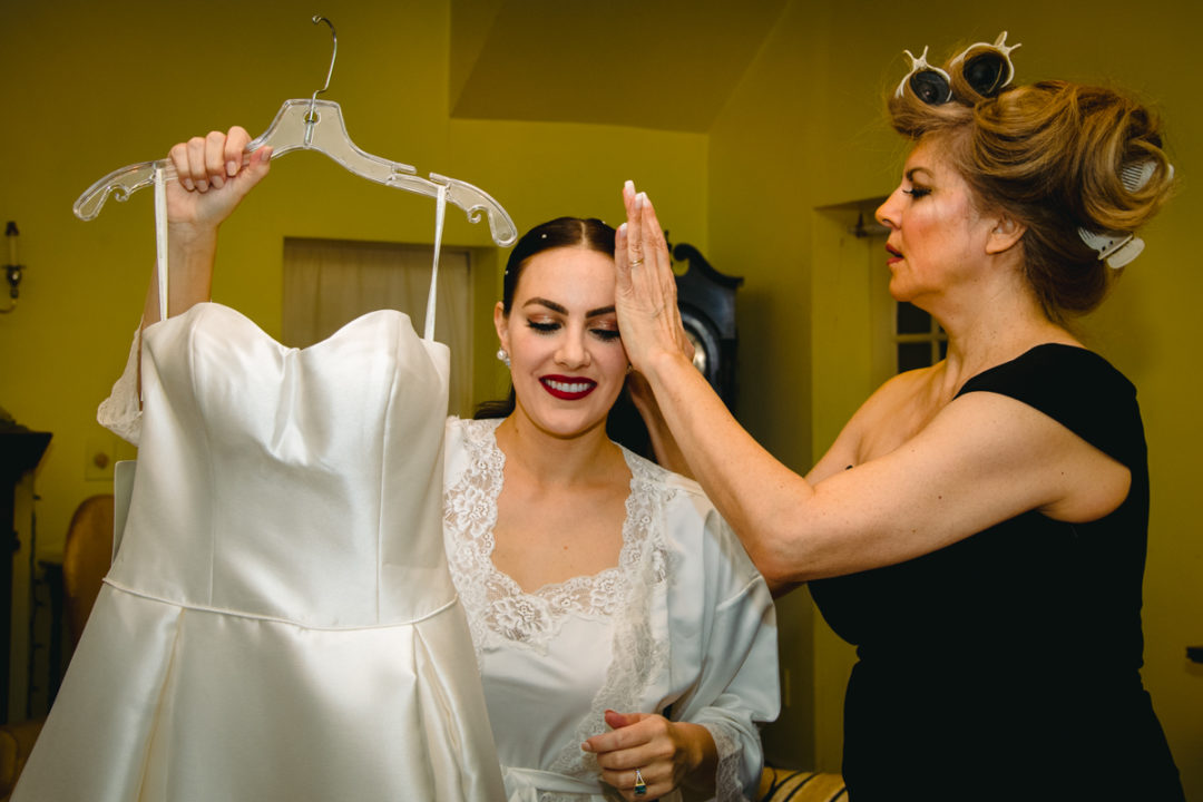 Bride getting ready with mom at Capitol Hill DC before church ceremony by DC wedding photographers of Potok's World Photography