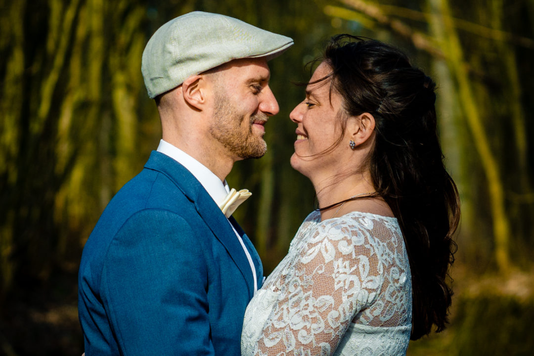 Couples portrait of bride and groom in the woods after micro wedding by DC wedding photographers of Potok's World Photography