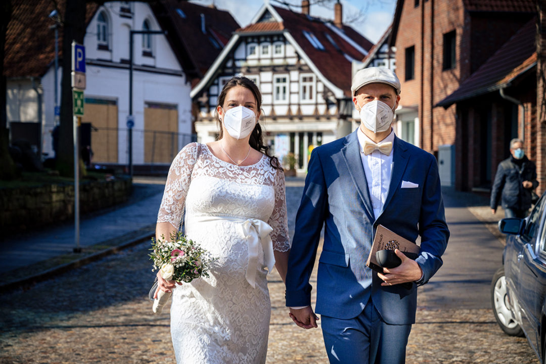 Bride and groom in masks for courthouse wedding during Covid-19 in Gehrden Germany by DC wedding photographers of Potok's World Photography