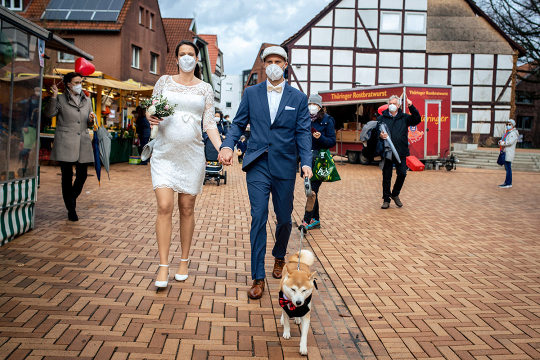 Bride and groom wearing masks and dog in a tux during a Covid-19 courthouse wedding in Gehrden Germany by DC wedding photographers of Potok's World Photography