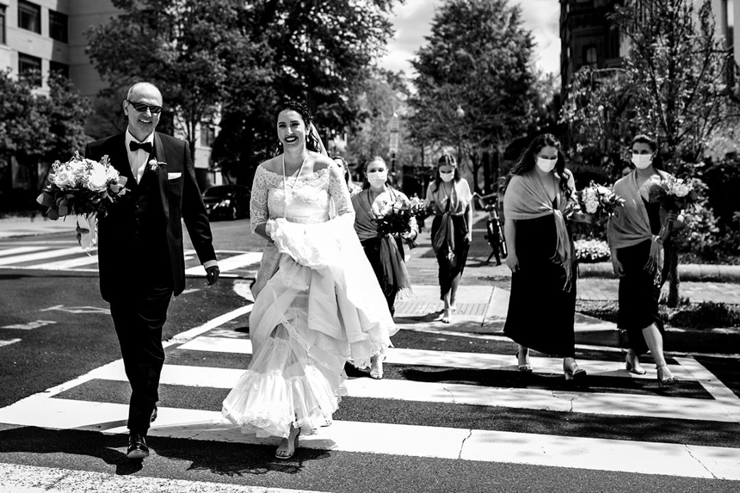 Bride, her dad and bridal party walking to church ceremony in Capitol Hill Washington DC by Potok's World Photography