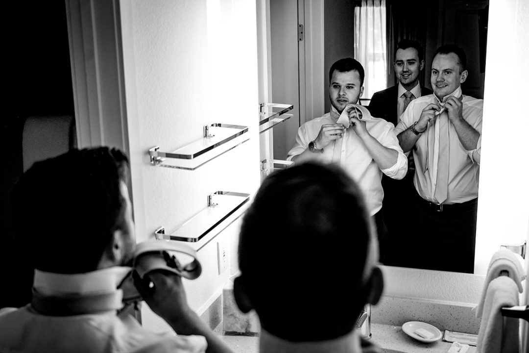 Groom and groomsmen getting ready at hotel before wedding ceremony at the Winery at Bull Run by DC wedding photographers of Potok's World Photography