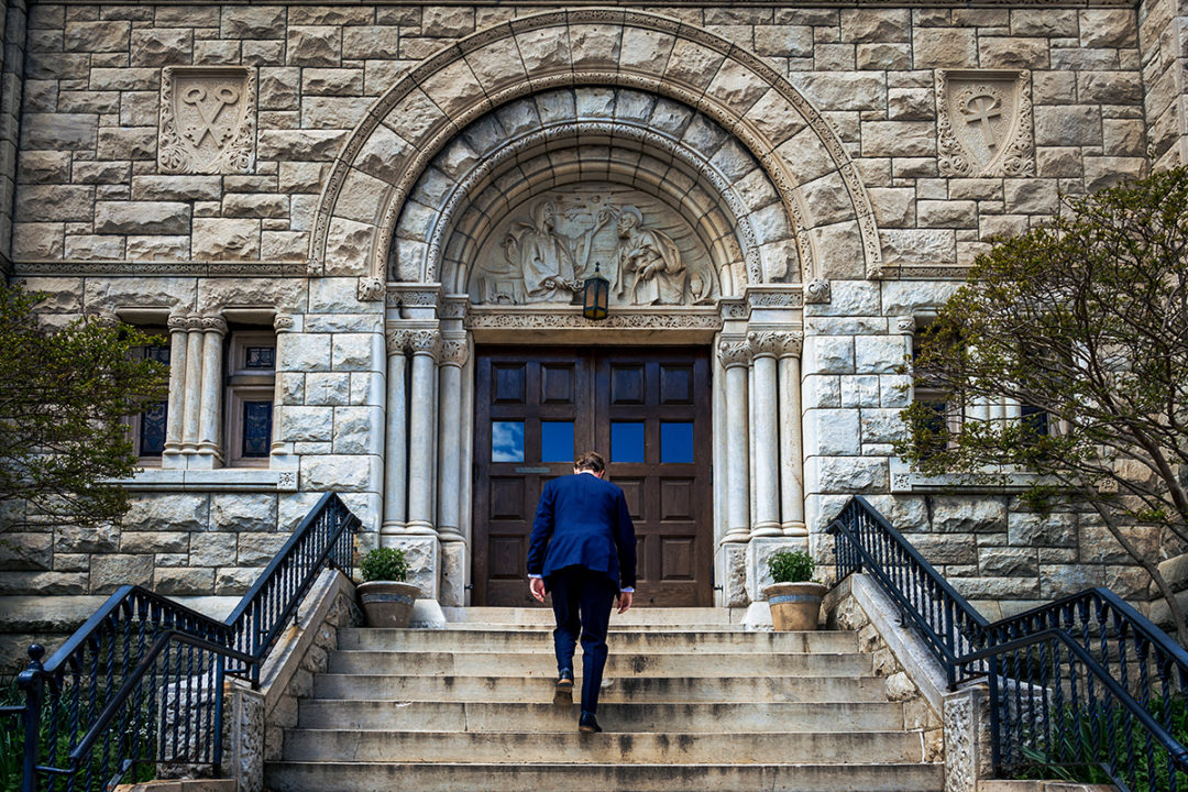 Groom walking in to church for wedding ceremony at Capitol Hill DC by Potok's World Photography